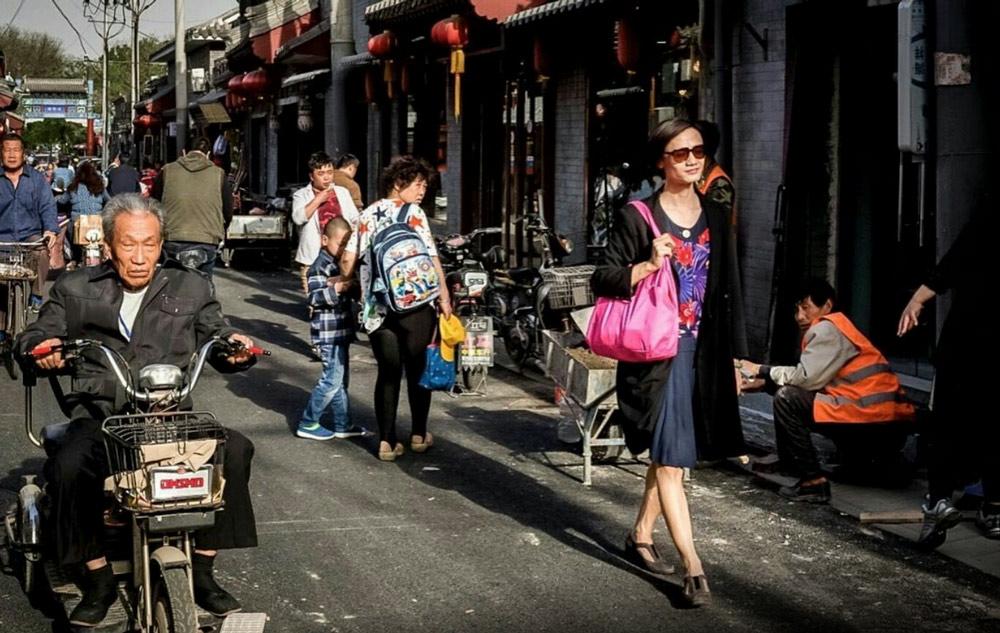 Chao Xiaomi walks down a street in Beijing. Courtesy of Chao Xiaomi