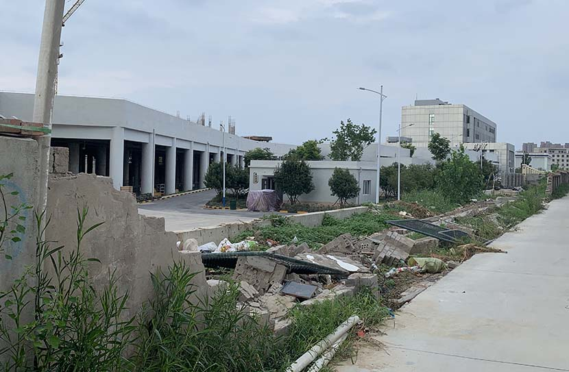 The flooding left a gap several meters wide in the wall surrounding the pumping station at the Wulongkou rail yard, Zhengzhou. July 28, 2021. Yuan Ye/Sixth Tone