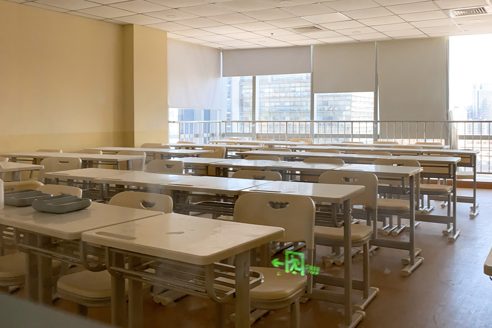 The empty classroom of a closed extracurricular training center in Beijing, June 2021. People Visual