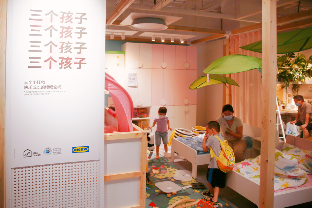 Customers inspect a showroom designed for families with three children at an IKEA store in Shanghai, Aug. 12, 2021. Chen Yuyu/People Visual