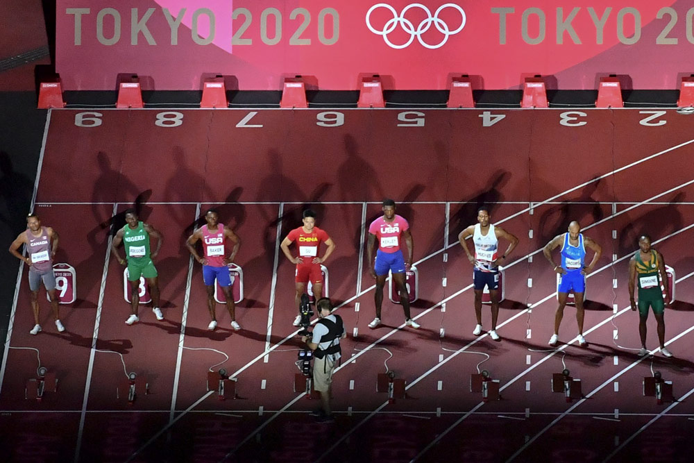 Athletes prepare for the men's 100-meter final at the Tokyo 2020 Olympic Games in Japan, Aug. 1, 2021. Antonin Thuillier/AFP via People Visual