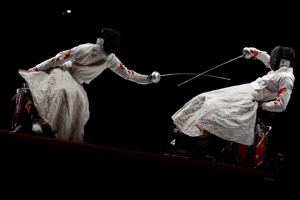 Tian Jianquan (right) competes against Sun Gang during a men's individual épée event in Chiba, Japan, Aug. 26, 2021. Zhang Lintao/People Visual