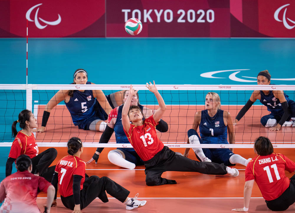 Zhao Meiling (No. 13) sets the ball during the women's sitting volleyball gold medal match in Tokyo, Japan, Sept. 5, 2021. Thomas Lovelock for OIS via IC