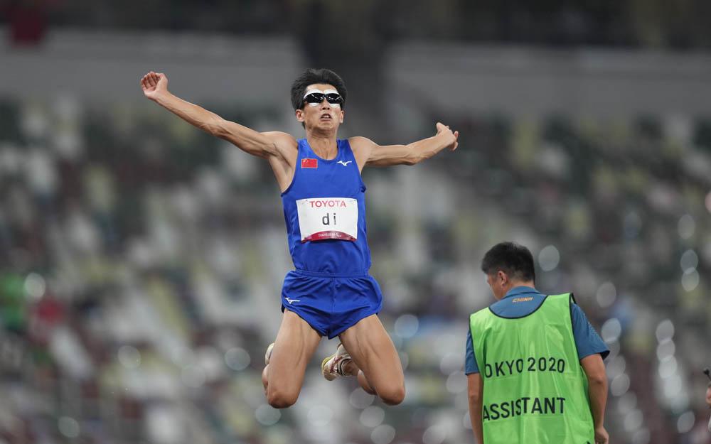 Di Dongdong competes in the long jump in Tokyo, Japan, Aug. 27, 2021. Ulrik Pedersen/NurPhoto via People Visual