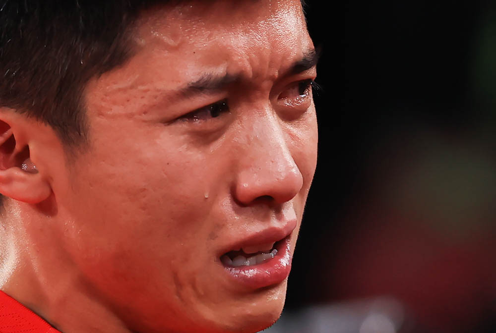 Zhai Xiang lets his emotions show after Team China's victory over Team Germany in a ping pong match in Tokyo, Japan, Sept. 2, 2021. Carmen Mandato via People Visual