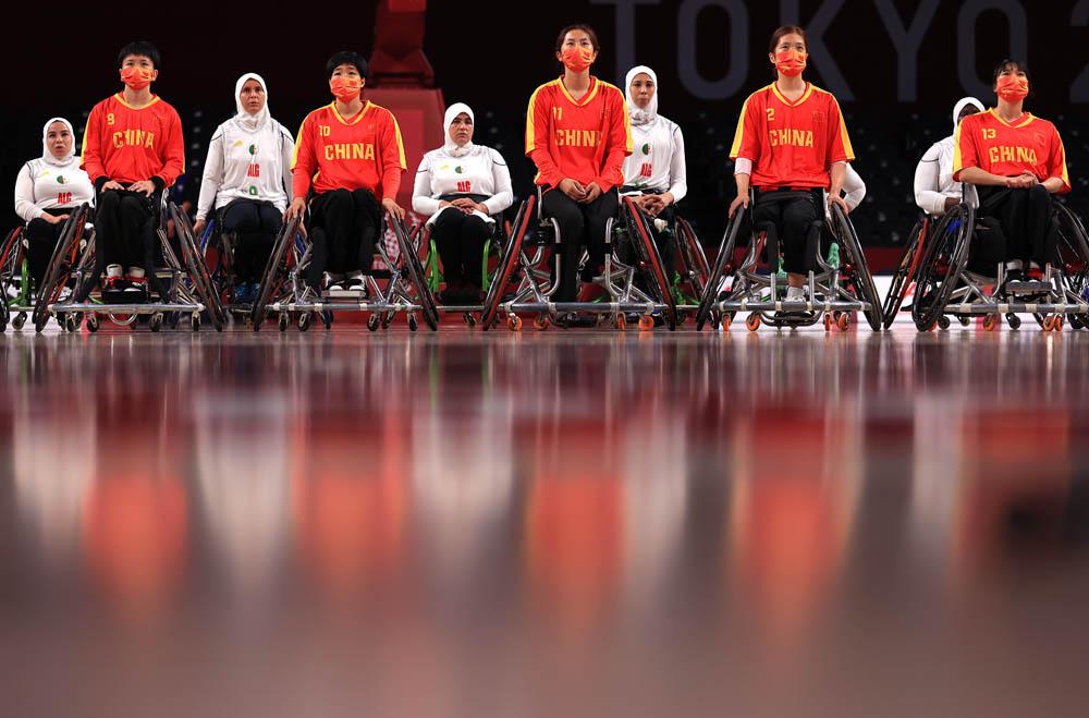 Team China and Team Algeria line up before a women's wheelchair basketball game in Chofu, Japan, Aug. 25, 2021. Carmen Mandato via People Visual
