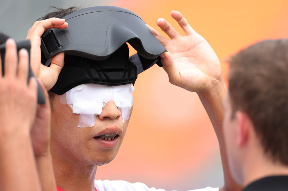 Liang Zhongzhi has his bandages inspected during a soccer match in Tokyo, Japan, Aug. 31, 2021. Carmen Mandato via People Visual