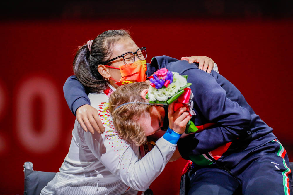Zhou Jingjing hugs gold medalist Beatrice Vio of Italy after their fencing match in Tokyo, Japan, Aug. 28, 2021. Mauro Ujetto/NurPhoto via People Visual