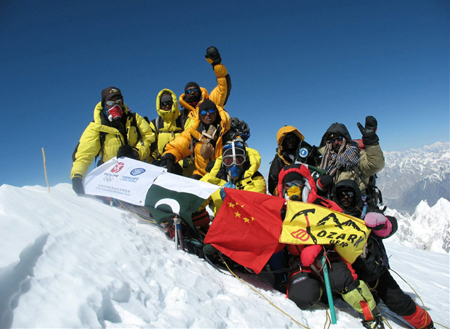 Luo Ze and other members of the China Tibet Mountaineering Team pose for a photo on Mt. Gasherbrum I, the 11th highest mountain in the world, on July 12, 2007. From China Tibet Mountaineering Association