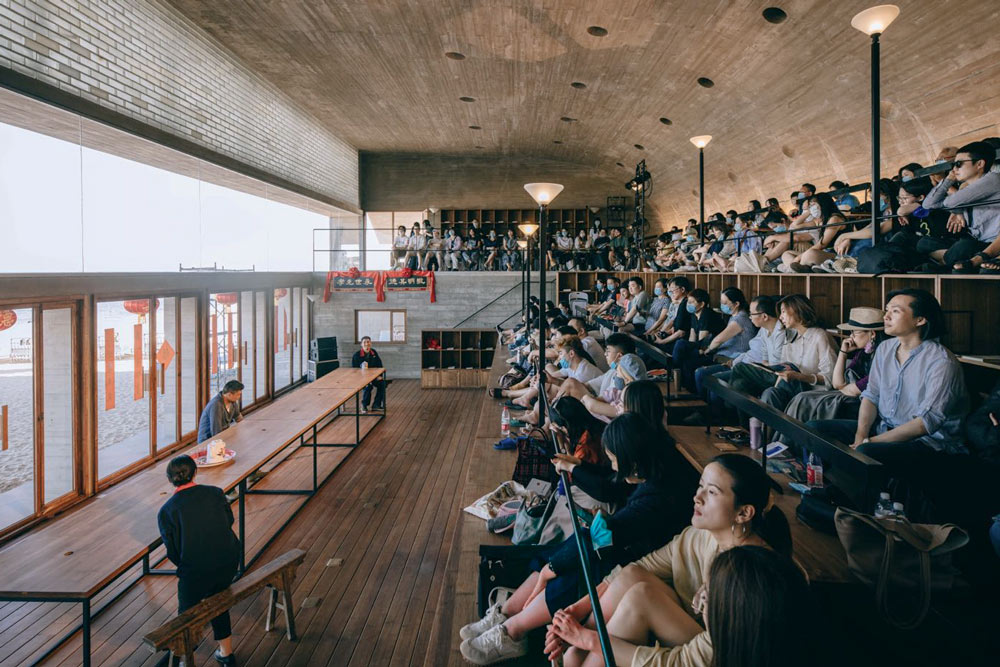 """Theatergoers watch the play """"Hometown"""" inside the Lonely Library in Aranya, Hebei province, 2021. Courtesy of Gao Ziwen"""