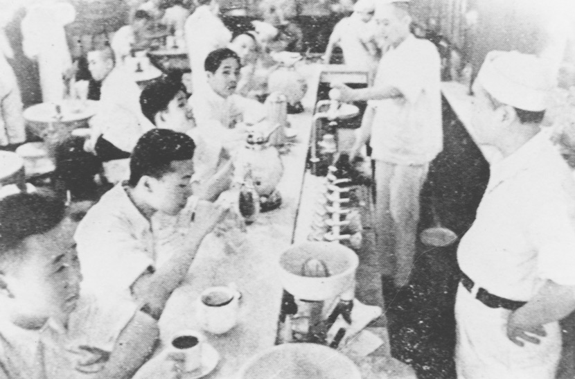 People snack on ice cream at a cold drink store in Shanghai, 1930s-1940s. From Shanghai Library