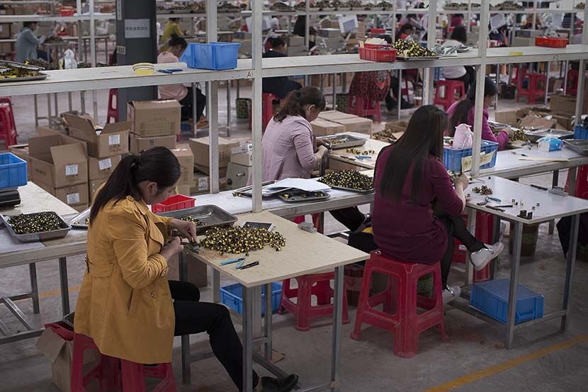 Women work at a workshop in Enshi, Hubei province, May 12, 2017. People Visual