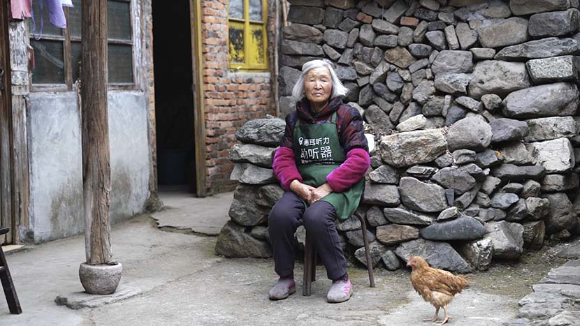 Jin Lifen's mother poses for a photo at her home in Zaokeng, Zhejiang province, Jan. 22, 2021. He Kai/The Paper