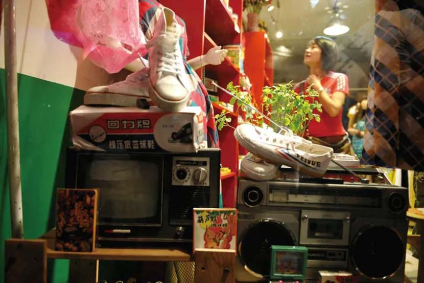A retro theme is part of a Feiyue store's branding in Beijing's Nanluoguxiang neighborhood. People Visual