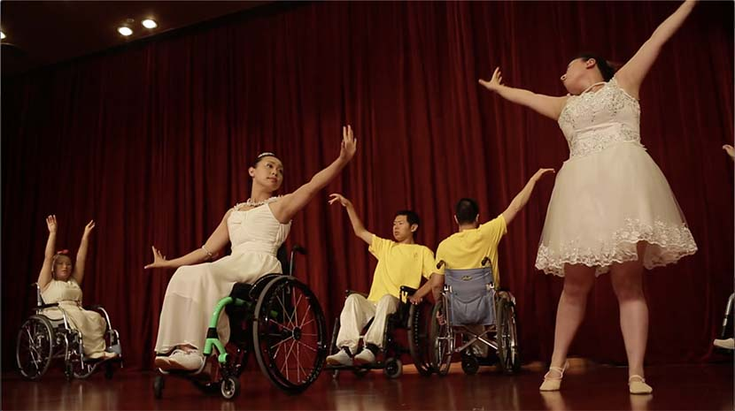 """Pan Jing (middle) and her fellow dance group members perform Home of Hope's first dance routine, which was set to the Chinese pop song """"I'm a Little Bird."""" Courtesy of Pan Jing"""