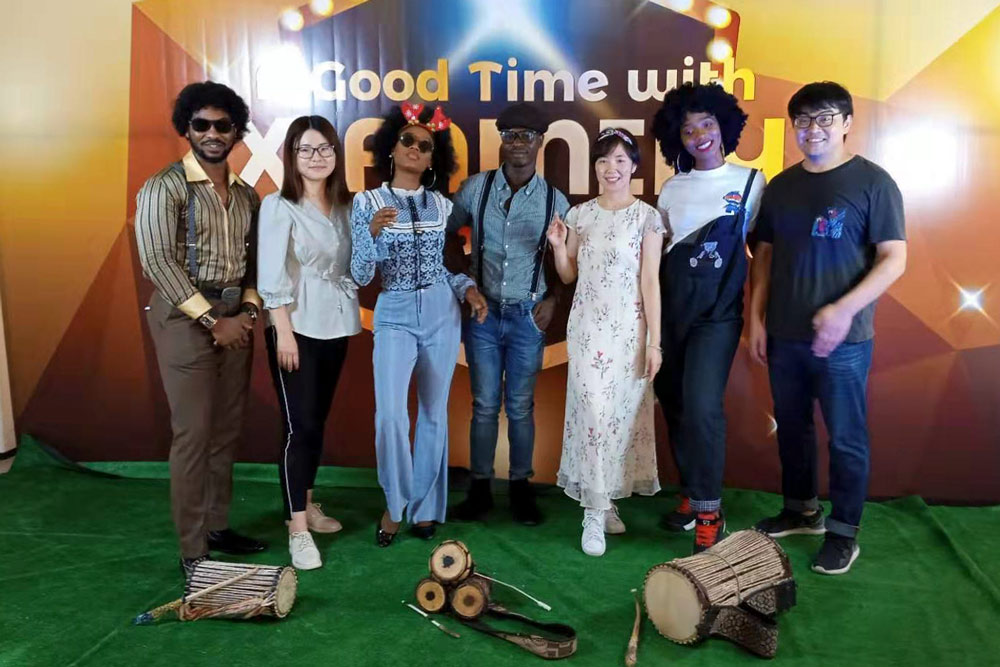 Zhang Yaqiong (third from right) attends a Christmas party with her friends in Lagos, Nigeria, 2019. Courtesy of Zhang