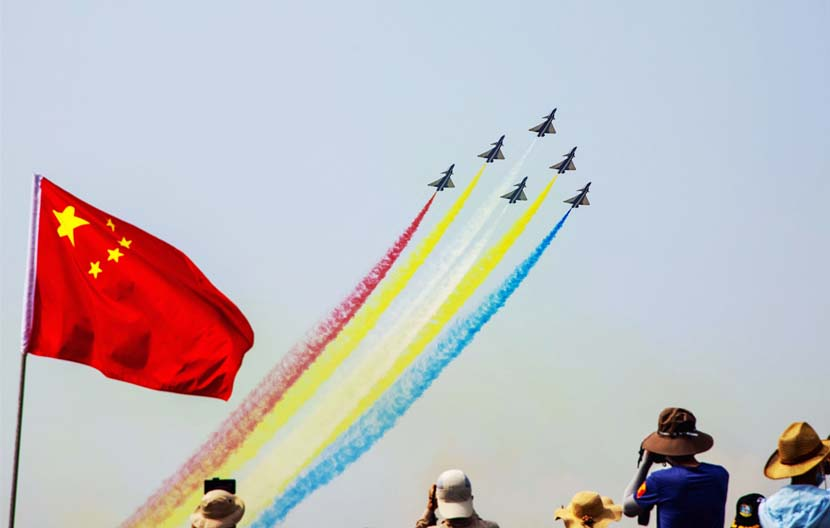 People capture the airshow at the 13th China International Aviation & Aerospace Exhibition in Zhuhai, Guangdong province, Oct. 1, 2021. People Visual