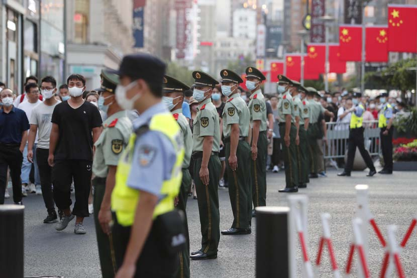 Police officers guard the Bund area in Shanghai, Oct. 1, 2021. Yin Liqin/CNS/People Visual