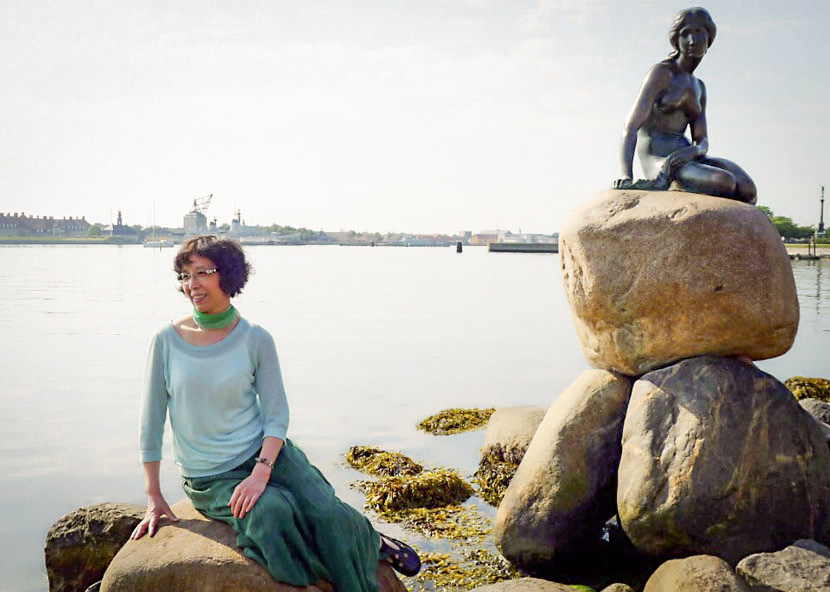 Ying Limin poses for a photo with Copenhagen's Little Mermaid statue during her trip to Denmark in 2014. Courtesy of Ying Limin