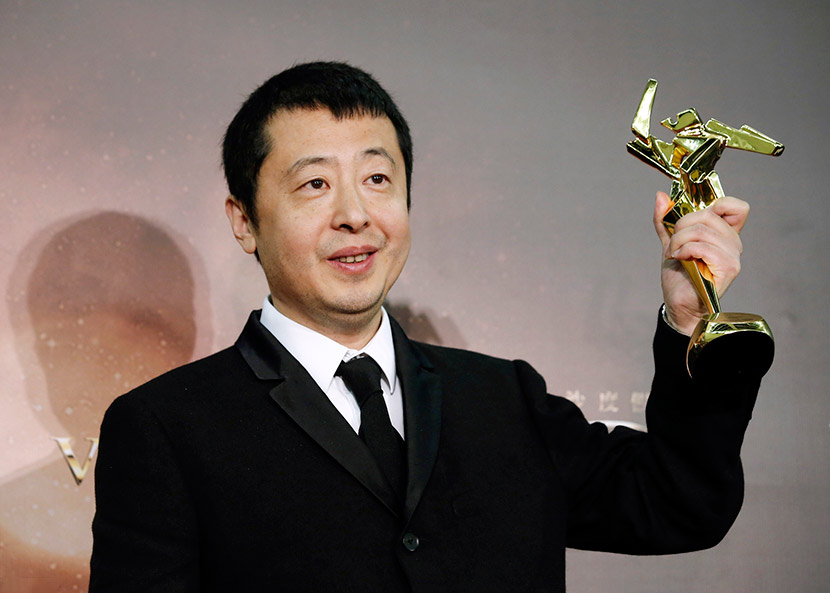 Director Jia Zhangke poses after winning the Best Screenplay award at the Asian Film Awards in Macau, March 17, 2016. IC