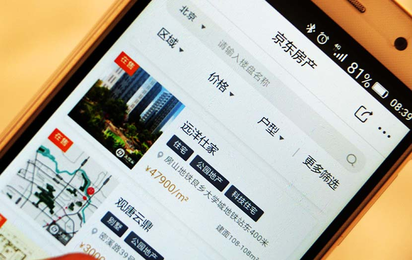 A cellphone displays the real estate section of JD.com's mobile app, Oct. 25, 2017. Jin Wen/IC