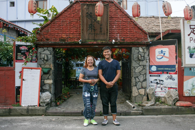 Chen Caixia (left) and her colleague, Chen Xiao, pose for a photo in front of her restaurant Up in the Wind in Pokhara, Nepal, Sept. 10, 2017. Bibek Bhandari/Sixth Tone