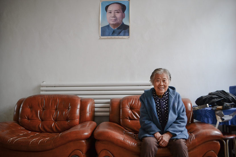 Zhang Peiying poses for a photo at her home in Beiwayao Village, Taiyuan, Shanxi province, Oct. 19, 2017. Fan Liya/Sixth Tone