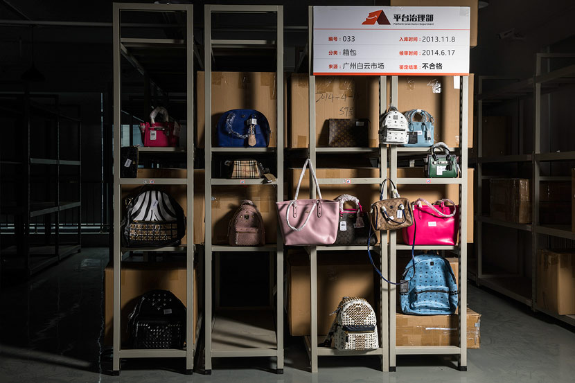 Handbags are displayed at a shelf inside the Alibaba's counterfeits warehouse in Hangzhou, Zhejiang province, June 14, 2017. VCG