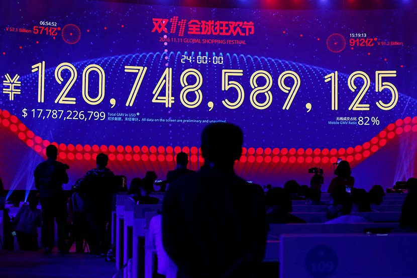 A screen displaying the total value of goods sold during Alibaba Group's 11.11 Singles' Day global shopping festival in Shenzhen, Guangdong province, Nov. 12, 2016. Bobby Yip/VCG