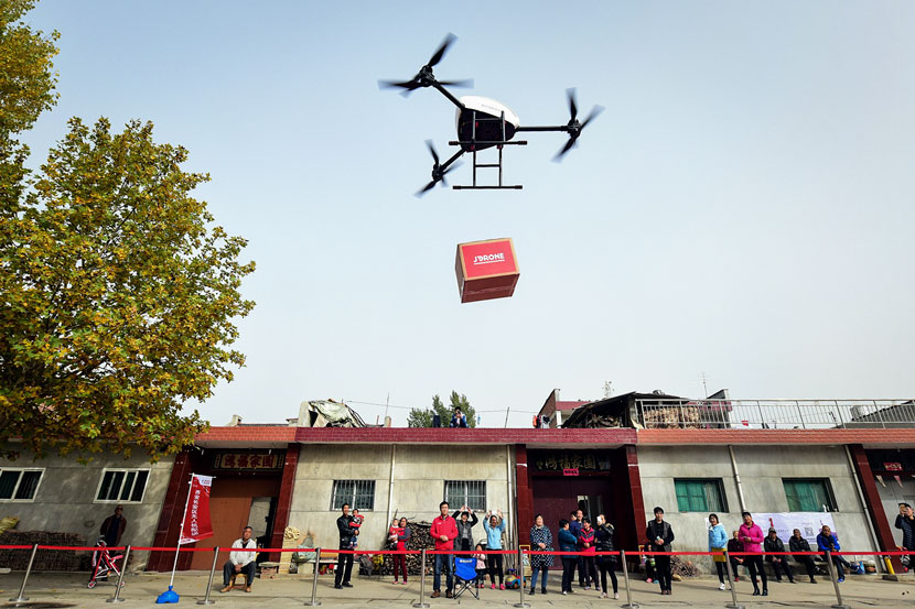 A drone releases a package from JD.com at a drop-off point in Xi'an, Shaanxi province, Nov. 10, 2016. Yuan Jingzhi/VCG