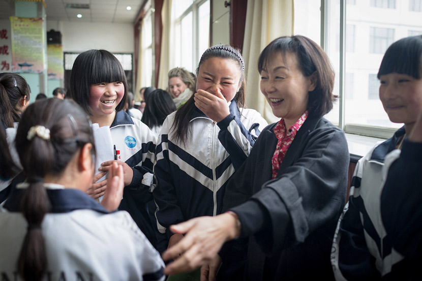 Ching Tien greets the female students she has sponsored through EGRC at No. 2 High School in Min County, Gansu province, April 6, 2016. Courtesy of Olivia Martin-McGuire