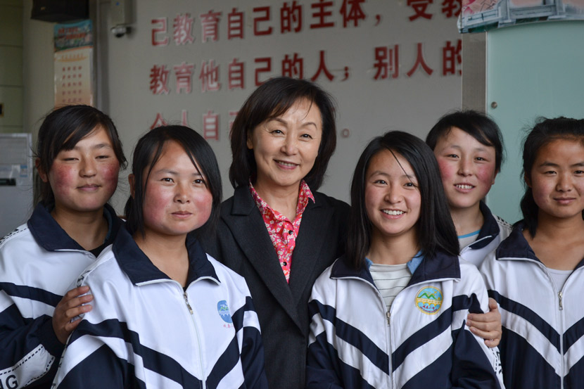 Ching Tien poses for a photo with students sponsored by EGRC at No. 2 High School in Min County, Gansu province, April 6, 2016. Courtesy of Olivia Martin-McGuire
