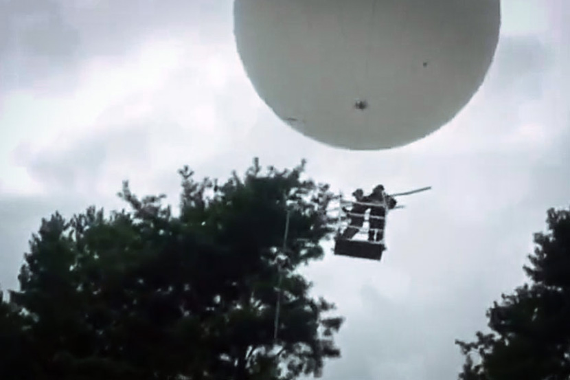 A screenshot from a video advertisement demonstrates how to pick pine nuts using a balloon. From Hangzhou Chiny Aircraft Technology Co. Ltd.