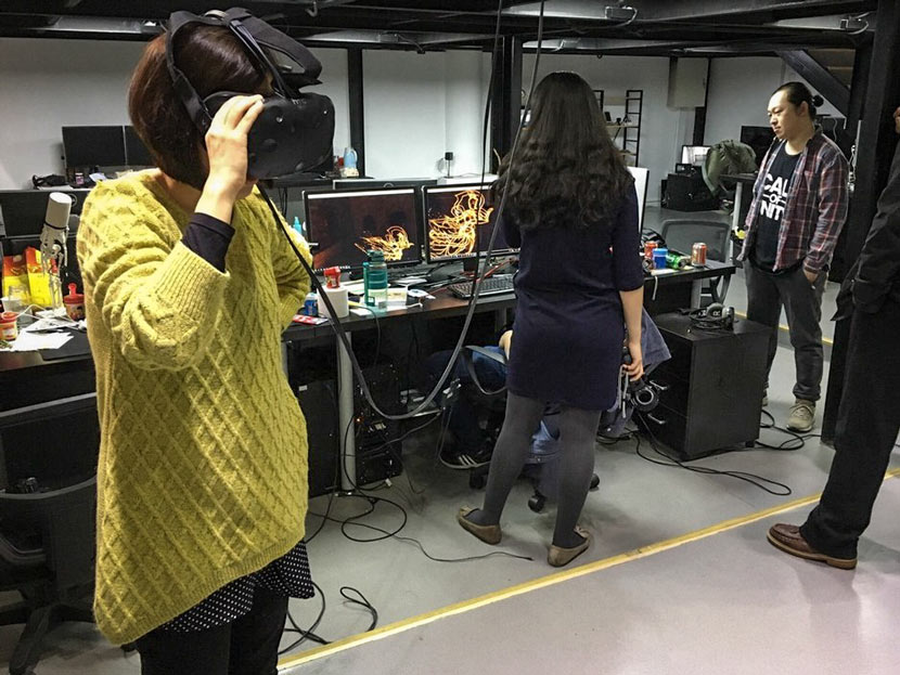 Zhao Qi's team test out virtual reality effects at their studio in Beijing, 2017. Courtesy of Zhao Qi