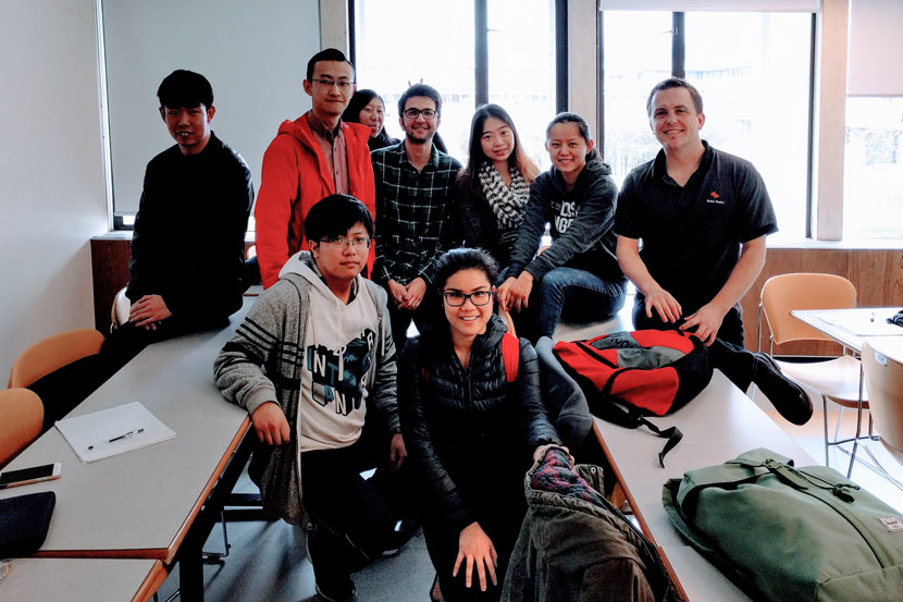 Wang Xinyue (back row, second from right) poses for a photo with her classmates and a professor at the Simon Fraser University campus in Vancouver, Canada, April 2017. Courtesy of Wang Xinyue