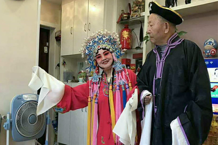 Cao Xuemei (left) and Cui Xingli wear Peking opera costumes while livestreaming at their home in Wuhan, Hubei province, Oct. 4, 2017. Courtesy of Cao Xuemei