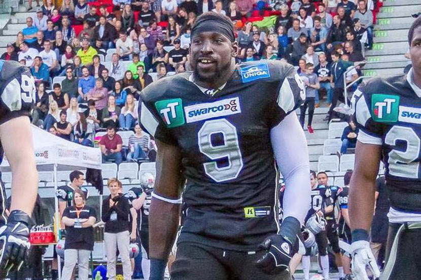 Wendell Brown walks onto the football field while playing for the Swarco Raiders of Innsbruck, Austria. Courtesy of Emma Liu