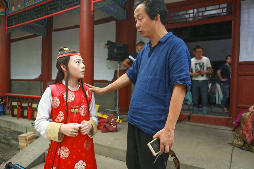 Pan Liping (right) talks to young actor Shi Xiaosong on the set of 'Dream of the Red Chamber' in Jinhua, Zhejiang province, 2017. Courtesy of Pan Liping