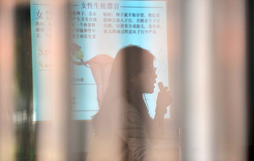 A teacher explains the female reproductive system during a class at a middle school in Langxi County, Anhui province, Nov. 10, 2017. IC