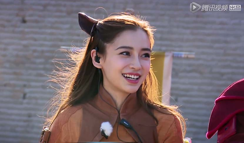 A screenshot from the TV show 'Kings Attack' shows Angelababy dressed as Daji the fox-demon sorceress.