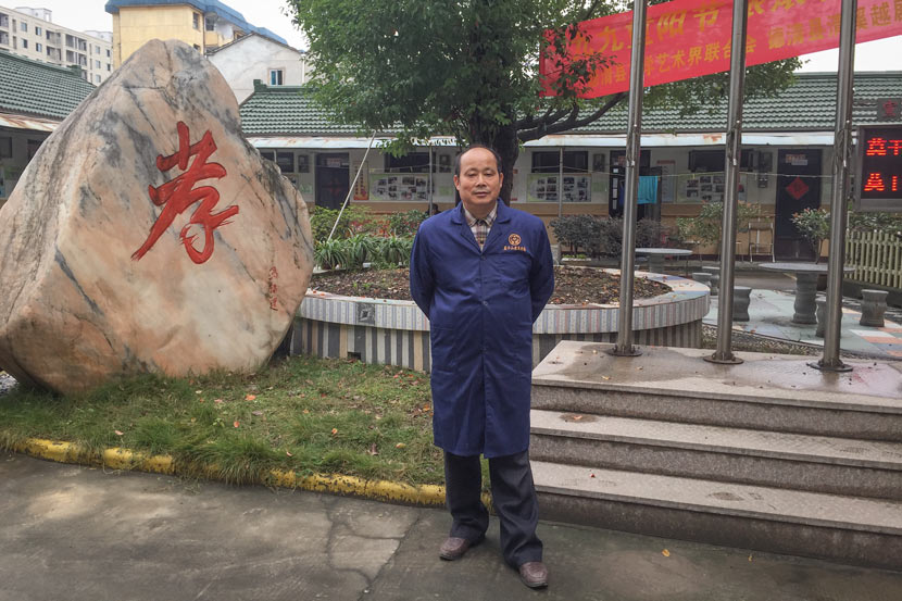Ma Fujian stands in front of his retirement home in Deqing County, Zhejiang province, Nov. 17, 2017. Fu Danni/Sixth Tone