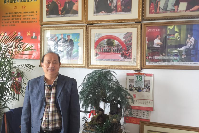 Ma Fujian poses for a photo in his office in Deqing County, Zhejiang province, Nov. 17, 2017. Fu Danni/Sixth Tone