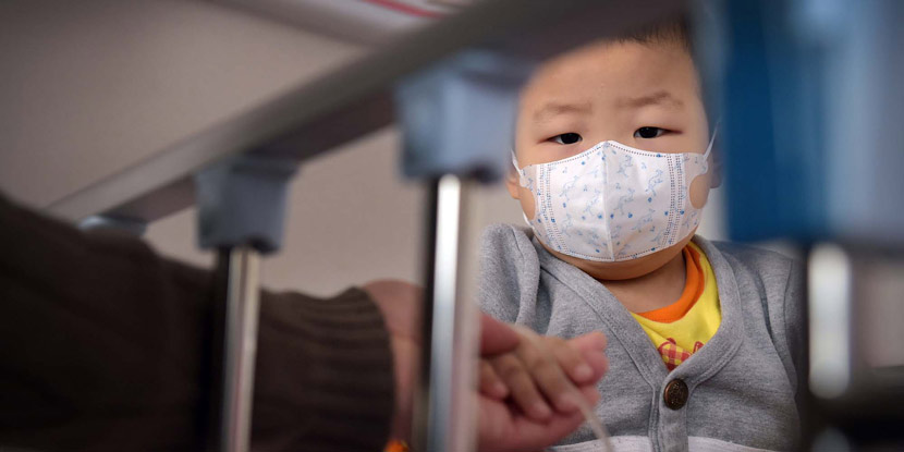 A boy with leukemia visits a hospital in Qingdao, Shandong province, Jan. 28, 2016. VCG