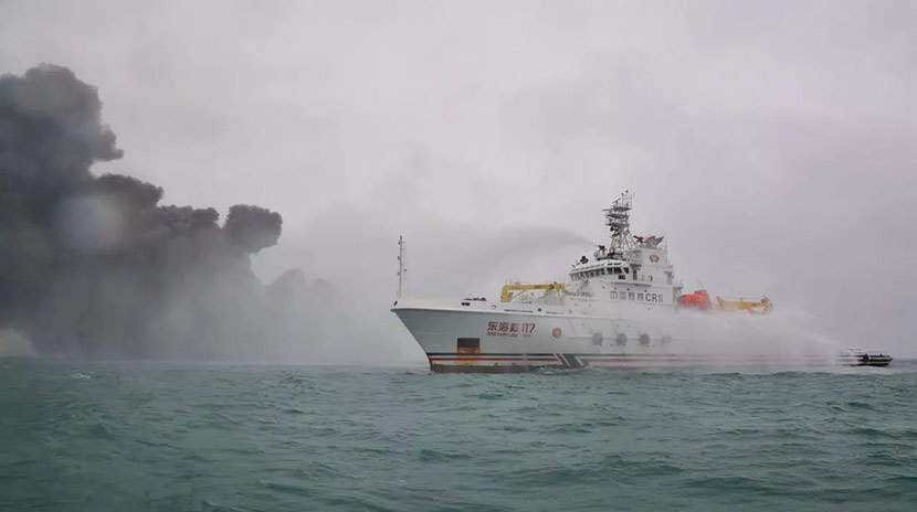 A rescue ship uses water cannons to extinguish the fire on the oil tanker Sanchi in open waters off the coast of China, Jan. 7, 2018. From the Chinese Ministry of Transport's WeChat account