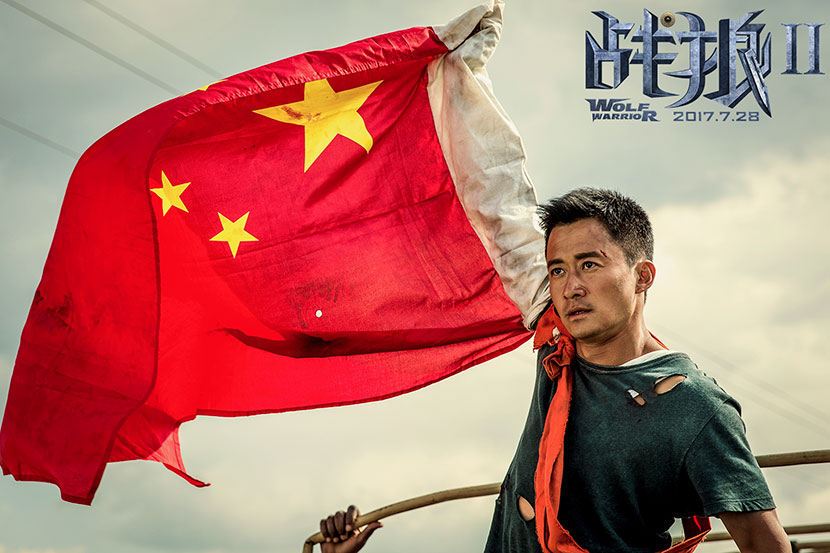 A promotional image for the film 'Wolf Warrior 2' shows protagonist Leng Feng raising the Chinese flag. IC