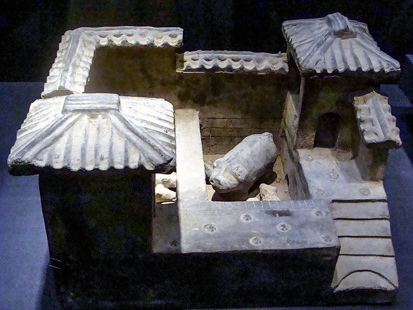A grey pottery 'pigsty' from the Han dynasty during an exhibition in Haikou, Hainan province, Jan. 30, 2011. The middle and left parts are pigpens, while the right part is a toilet. Peng Tong/VCG