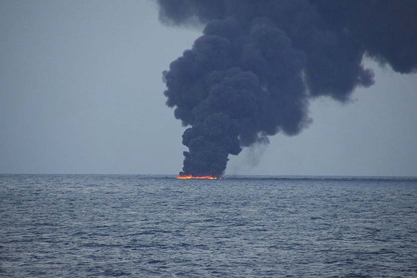 Flames and smoke from the Iranian oil tanker Sanchi are seen in the East China Sea, Jan. 15, 2018. 10th Regional Coast Guard Headquarters/Reuters
