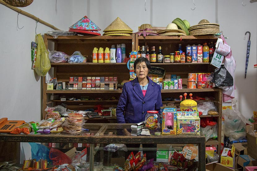 Shen Xiaoyan poses for a photo at her grocery store in Wencun Village, Fuyang, Zhejiang province, Nov. 16, 2017. Denise Hruby/Sixth Tone