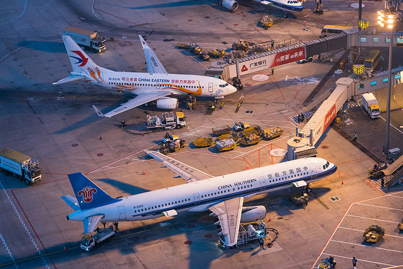 Airplanes parked at Beijing Capital International Airport during the beginning of the Spring Festival travel rush, Feb. 6, 2018. Wan Quan/China Pictorial/VCG
