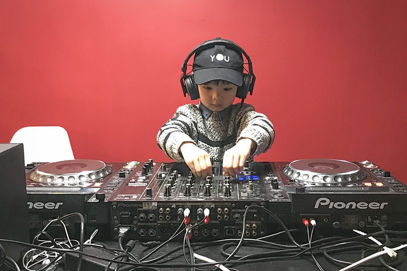 Yan Zichen, 4, practices DJing at music school EM MUSIC in Shanghai, Dec. 16, 2017. Courtesy of Jiao Ziqi